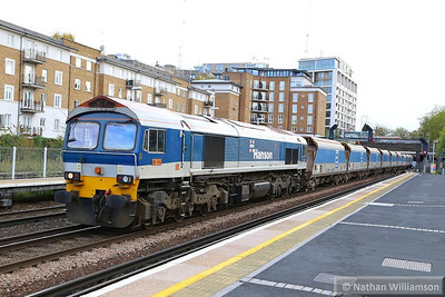 59101 heads north through Kensington Olympia working the: 7V66 10:52 Purley to Acton Yard  14/11/13