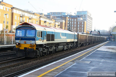 59103 heads north through Kensington Olympia working the: 7V06 11:20 Crawley to Acton Yard  12/12/13