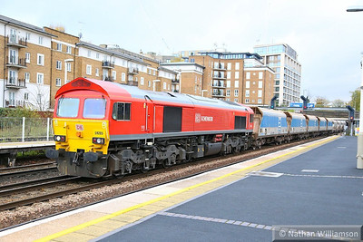 59205 heads north through Kensington Olympia working the: 7V66 10:52 Purley to Acton Yard  21/11/13