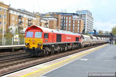 59206 heads north through Kensington Olympia working the: 7V75 09:35 Angerstein Wharf to Acton Yard  21/11/13