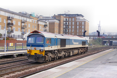 59103 heads north through Kensington Olympia, light engine running as the: 0F03 13:00 Hither Green to Acton Yard 15/03/11