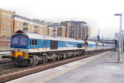 59104 heads north through Kensington Olympia on the: 6V18 12:46 Hither Green to Whatley Quarry 15/03/11