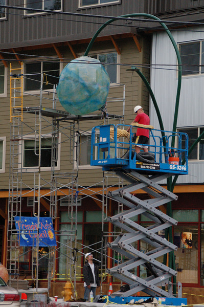 June 15, 2007, the day before the Fremont Fair, I was walking in Fremont and noticed artists installing the globes onto the ArtSPACE artwork at 36th Street and Evanston Ave N.  This is the newest permanent public artwork in Fremont.