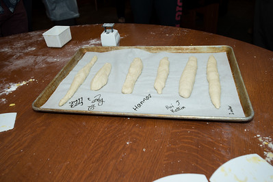 French III class baking baguettes