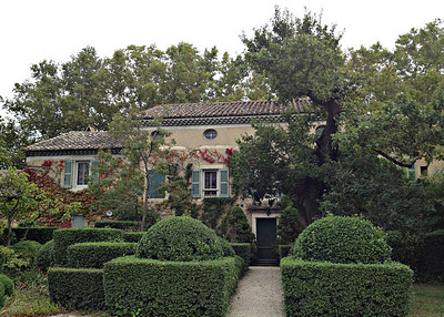 The home is lovely with vines growing on the stucco and taking the colors of autumn.