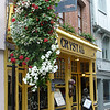 Flowers are just the standard in France.  These hanging baskets were three tiered pots.