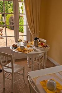 Our pretty creamy yellow breakfast room