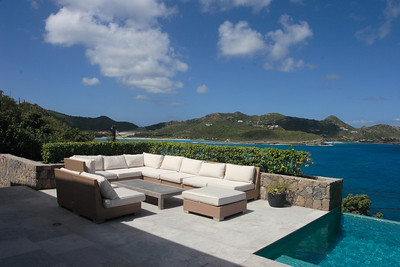 Saint Barth - Villa Ella, aka SIB BBSIn St. Jean, stone walls and turquoise tiles lead up to the commanding ocean view and impressive 55' (17m) pool