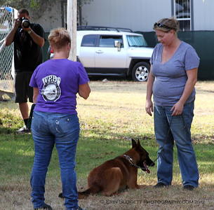 Evaluator, Leri Hanson, with Erin Kramer & Tripp during SAFE Dog test.  A multitude of temperment evaluation tests take place at the  SCABR French Ring trial in Long Beach, CA on July 13, 2012  © Erin Suggett Photography 2012 - All Rights Reserved
