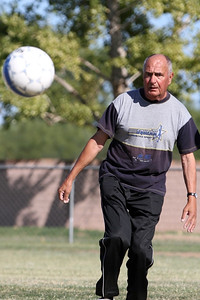 Judge Agremont participates in the soccer game that took place during the Decoy Super Selection verbal test > practical field work break.  © Erin Suggett Photography 2012 All Rights Reserved