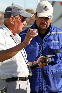 Judge Agremont explains how he has scored the Long Jump to Ring III competitor, Adrian Centeno.  © Erin Suggett Photography 2012 All Rights Reserved