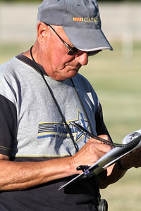 Judge Agremont fills out a scoresheet during the Decoy Super Selection practical field test.  © Erin Suggett Photography 2012 All Rights Reserved