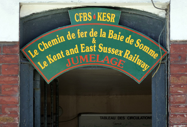 Bienvenu au CF Baie de Somme!  St Valery Canal, Sat 26 May 2012.  The 14km line runs in a horse shoe from Le Crotoy, on the north side of the bay, to St Valery, on the south side.  Trains reverse and change locos at Noyelles, where the line meets SNCF's Abbeville - Boulogne line.  There is also a long but little used branch from St Valery to Cayeux.  The line is metre gauge, though the Noyelles - St Valery section is dual metre and standard gauge.  As can be seen, the Baie de Somme is twinned with the Kent & East Sussex in England.