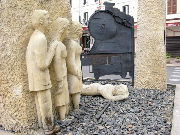 Montlucon, 2 May 2005 3.  Resistance memorial.  On 6 January 1943 the inhabitants of Montlucon prevented a train taking men for forced labour in Germany from leaving the town.  All the men excaped.