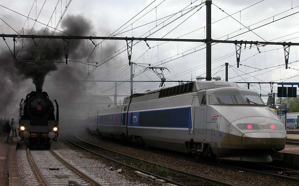 SNCF 231.K.8 & TGV 64, Dijon Ville, Fri 6 May 2005 1 - 1609.  The last leg of the Mediterranean Steam Express, and the Pacific brews up ready for the departure to Paris.  It was one hour late.
