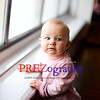 Lifestyle portrait of cute 1 year old girl