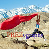 Woman exercises with flag in mountains