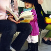 Jami Cakes and Lovey read a book at Canyon School in Hollywood, CA