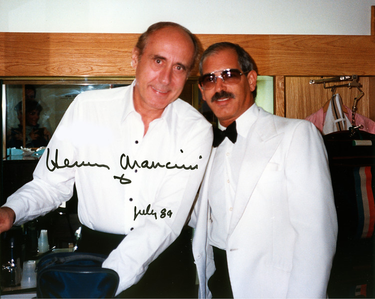 Conductor/Composer Henry Mancini and LA PHIL Violist Jerry Epstein schmooze backstage at the Hollywood Bowl during intermission.