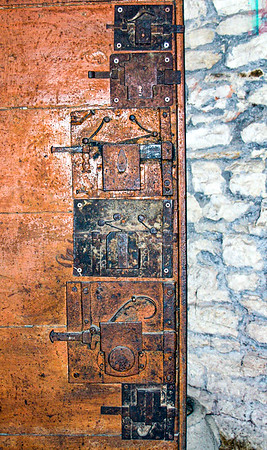All the locks on the door of the winery at Castello di Verrazanno in Greve, Italy