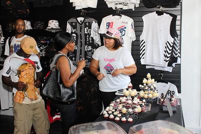 Stylish Guests Enjoying Conversation and CupCake Mafia's Cupcakes