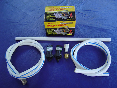 So the alternative was this 12 volt pump.  Some of the parts are:  12 volt pump, PVC pipe, garden hose and fitings.