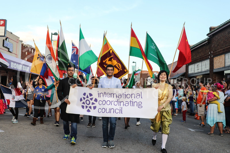 The International Coordinating Council marches in Kansas State's Homecoming Parade in Aggieville while carrying flags representing some of the different nationalities at Kansas State University on Friday October 20th, 2017. (Photo by Cooper Kinley | Collegian Media Group)