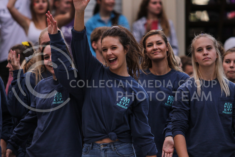 Members of the Alpha Xi Delta sorority dance to music prior to the Homecoming Pep Rally on Friday, Oct. 20, 2017. (Photo by Cooper Kinley | Collegian Media Group)