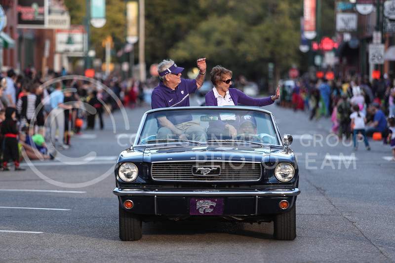 Kansas State University president, Richard Meyers, and his wife, Mary Jo Meyers, ride in an antique Ford Mustang convertible during the Kansas State Homecoming Parade on Friday, Oct. 20th, 2017. (Photo by Cooper Kinley | Collegian Media Group)