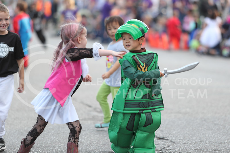 Kids play with one another during Trick or Treat in the Ville on Friday Oct.<br />  20th, 2017. (Photo by Cooper Kinley | Collegian Media Group)