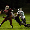 Isaul Fiqueron of Fitchburg High pulled down by Wachusett defense during the first half of Friday nights game at Crocker Field.  Sentinel & Enterprise photo/Jeff Porter