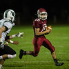 Andrew Brooks of Fitchburg High runs the ball wide around Wachusett defense during the second half of Friday nights game at Crocker Field.  Sentinel & Enterprise photo/Jeff Porter
