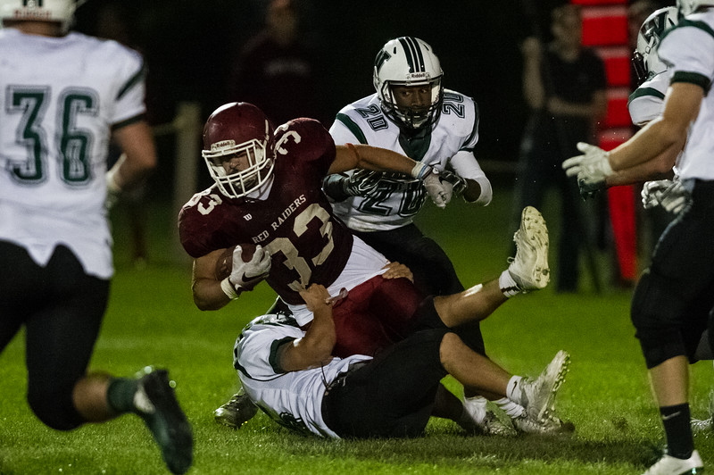 Alex Marrero of Fitchburg High pulled down by Wachusett defense during the first half of Friday nights game at Crocker Field.  Sentinel & Enterprise photo/Jeff Porter