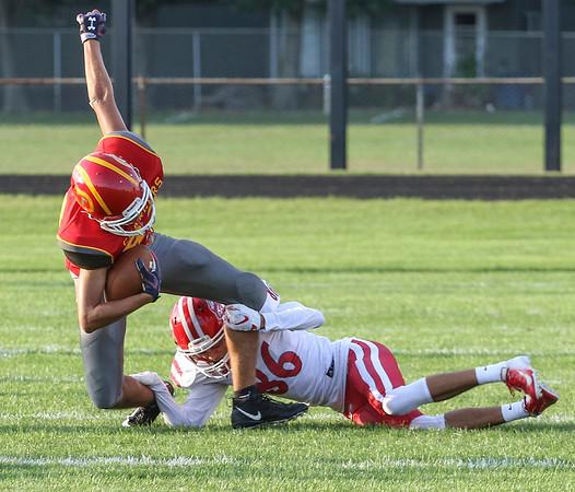 Branden Beachy | The Goshen News<br /> Goshen senior Tomas Fuentes makes a tackle at Friday night's game in Elkhart.
