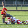 Branden Beachy | The Goshen News<br /> Goshen senior Tomas Fuentes makes a tackle at Friday night's game in Elkhart.