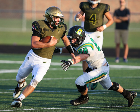 CHAD WEAVER | THE GOSHEN NEWS<br /> Wawasee running back Aaron Evans escapes a tackle by Northridge defensive lineman Reece Lueking (88) during the first quarter of Friday night's game at Wawasee.