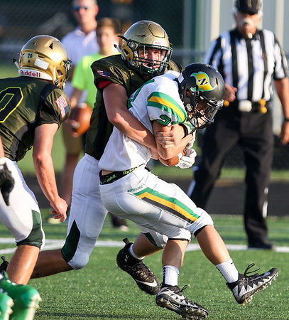 CHAD WEAVER | THE GOSHEN NEWS<br /> Wawasee defensive lineman Isaiah Tipping tackles Northridge running back Tug Modglin (21) during the first quarter of Friday night's game at Wawasee.
