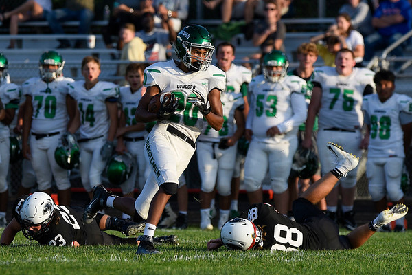 BEN MIKESELL | THE GOSHEN NEWS<br /> Concord freshman Amarion Moore evades defenders in the first quarter of Friday's game against host NorthWood High School.