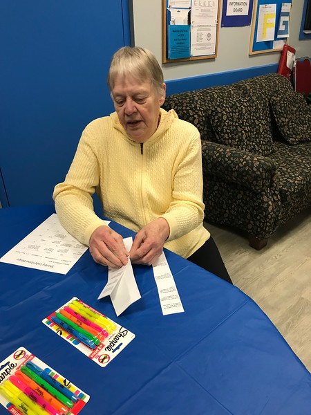 Lucille Robinson concentrating on making her bingo card.