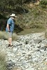 24/03/2018 - Sandy walking across the limestone dry bed of Cave Creek near Blue Waterholes