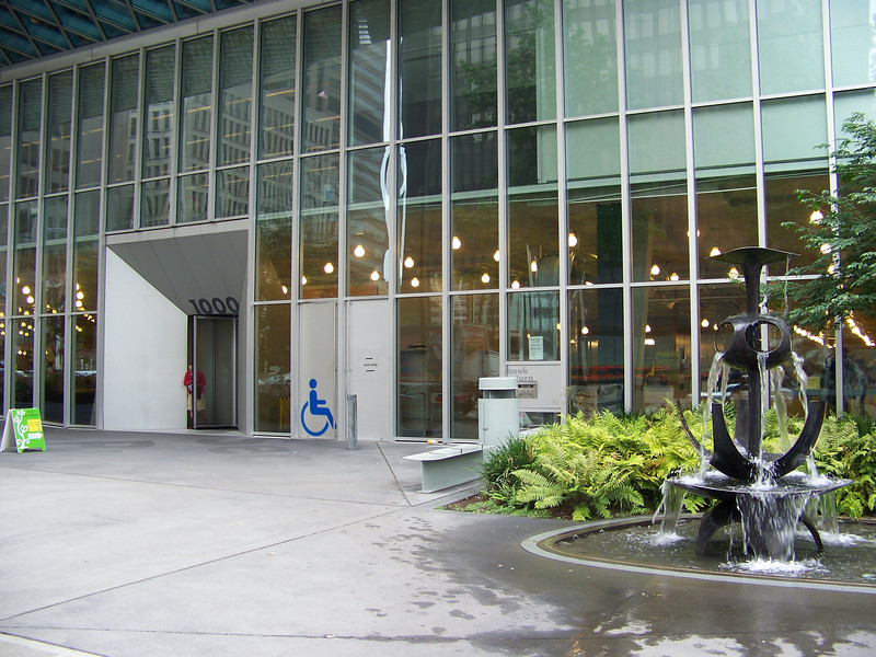 "July 2010.  Revolving door exterior on 4th Ave.  The fountain designed by <b><a target=""_new"" href=""http://en.wikipedia.org/wiki/George_Tsutakawa"">George Tsutakawa</a></b> is on the right."