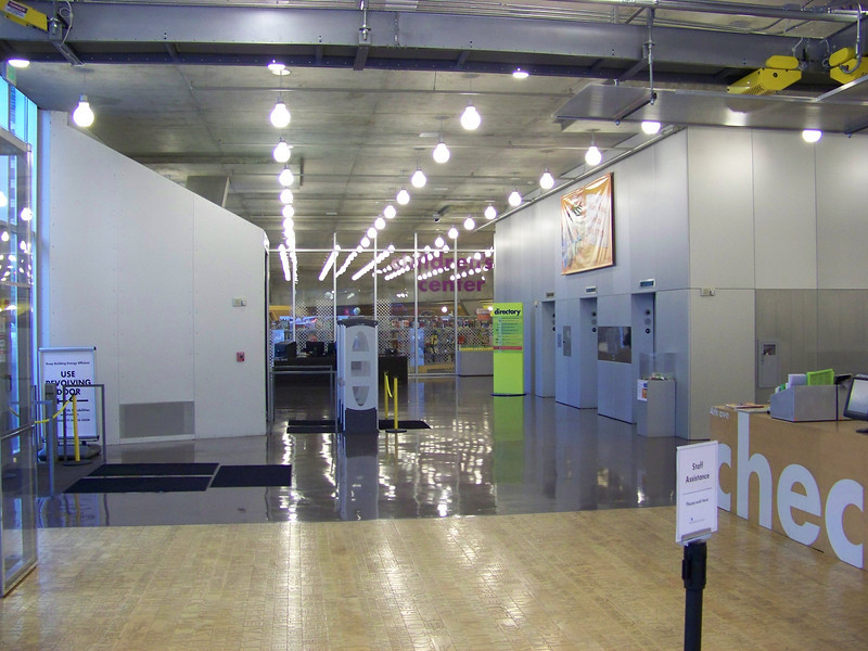 July 2010.  Standing in front of the check-out desk.  Revolving doors to the left, Children's Center in back.