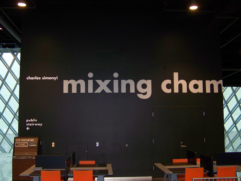 "July 2010.  The ""Mixing Cham"" wall in the Mixing Chamber.  <b><a target=""_new"" href=""http://en.wikipedia.org/wiki/Charles_Simonyi"">Charles Simonyi</a></b> donated money to the library (about $3 million), so this floor is named for him.  Note the 1970s-era change machine to the left.  We used this machine for many, many years at Old Central before this building opened!"