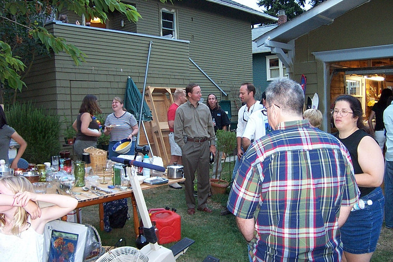 Dave (in plaid), with Gina to his right.  In the background, Mary Lou is talking to Jeff's wife Terry (in the striped shirt).<br /> [Kirk & Mary Lou's farewell party and garage sale - August 2003]