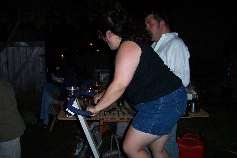 Gina tries out the stair climber.<br /> [Kirk & Mary Lou's farewell party and garage sale - August 2003]