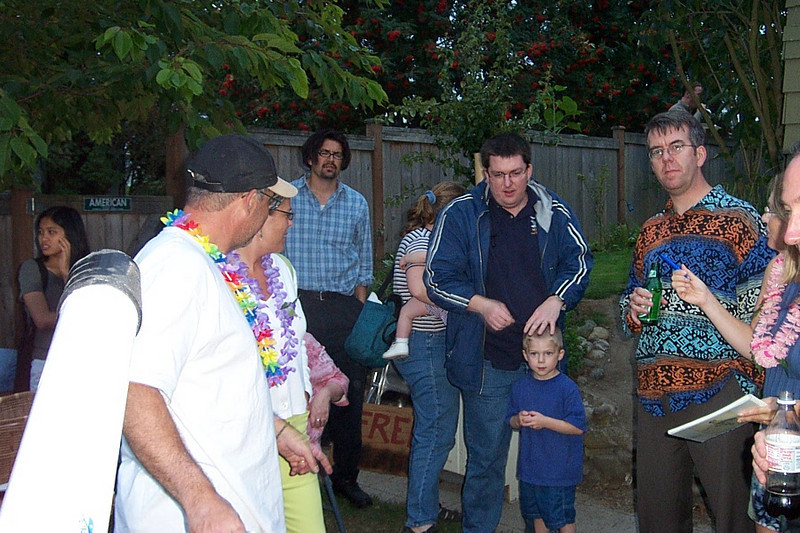Jaime (in light blue), and Jeff (in dark blue coat) with his hand on his son Greg.<br /> [Kirk & Mary Lou's farewell party and garage sale - August 2003]