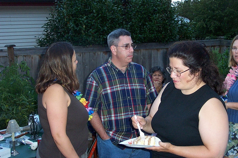 Mary Lou, Dave, and Gina.  In the background between Dave and Gina is Mary Lou's mom Ursula.<br /> [Kirk & Mary Lou's farewell party and garage sale - August 2003]