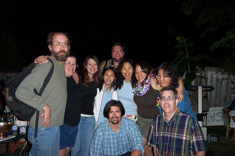 Standing: Carl, Gina, Tami, Thuy, Jon, Emily, Mary Lou, Kay.  Kneeling: Jaime and Dave.<br /> [Kirk & Mary Lou's farewell party and garage sale - August 2003]