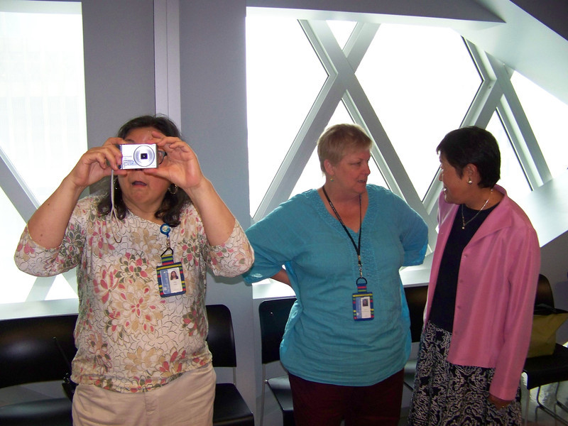 Kay photographs me photographing her.  At right are Heather and SPL retiree Betty Tonglao.<br /> [Megan's retirement party - August 1, 2013]