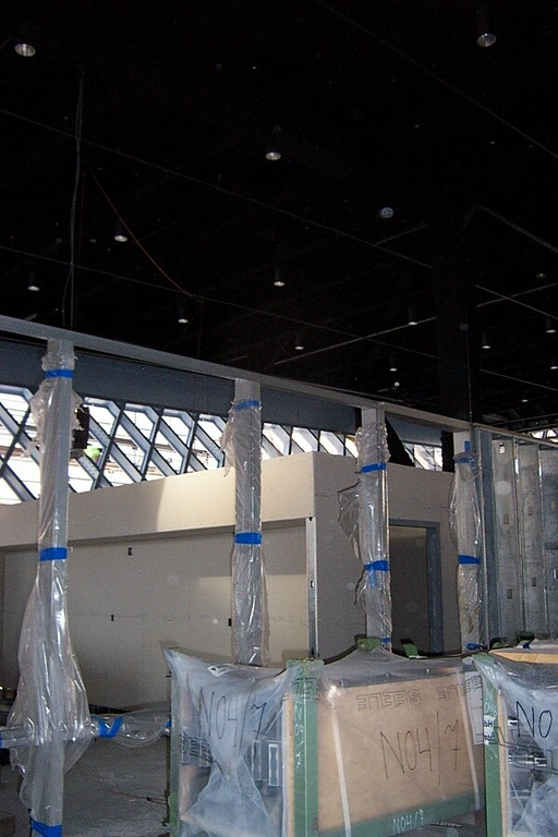 The Mixing Chamber reference desk will go right in front of the unfinished wall seen here with the pillars wrapped in plastic.  Those pillars are the window frames, and the Legrady video art installation will be above the windows at top.